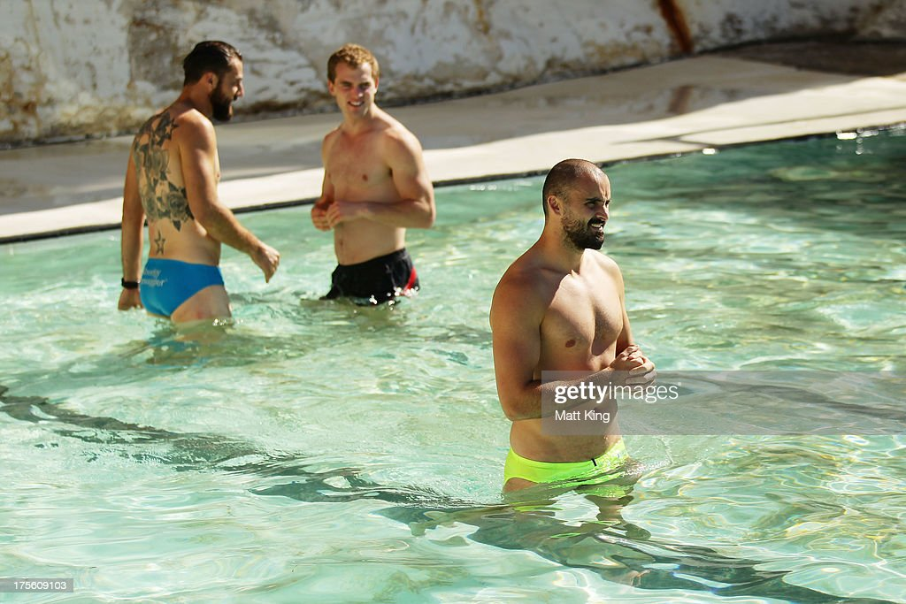 Nick Malceski, Tom Mitchell and Rhyce Shaw cool their legs during a Sydney Swans AFL recovery session at Bondi Icebergs Pool on August 5, 2013 in Sydney, Australia.