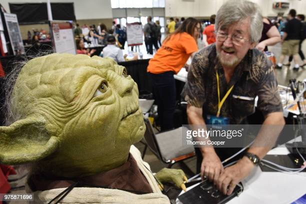 Nick Maley special makeup and creature FX artist on Star Wars and other movies shows how Yoda moves at Denver ComicCon held at the Colorado...