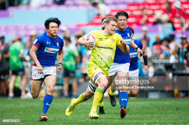 Nick Malouf of Australia is tackled during the 2017 Hong Kong Sevens match between Australia and South Korea at Hong Kong Stadium on April 8 2017 in...