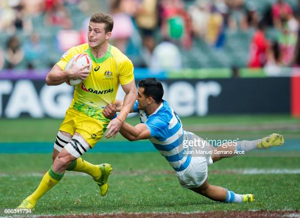 Nick Malouf of Australia is tackled during the 2017 Hong Kong Sevens match between Australia and Argentina at Hong Kong Stadium on April 9 2017 in...