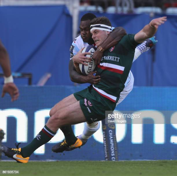 Nick Malouf of Leicester is high tackled by Virimi Vakatawa during the European Rugby Champions Cup match between Racing 92 and Leicester Tigers at...