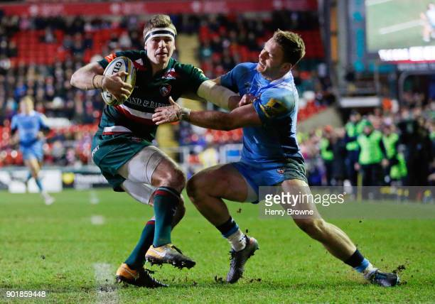 Nick Malouf of Leicester Tigers and Alex Lewington of London Irish during the Aviva Premiership match between Leicester Tigers and London Irish at...