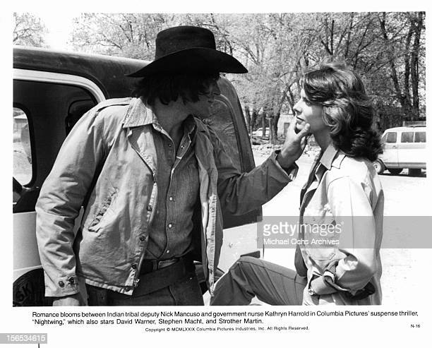 Nick Mancuso flirts with Kathryn Harrold in a scene from the film 'Nightwing' 1979