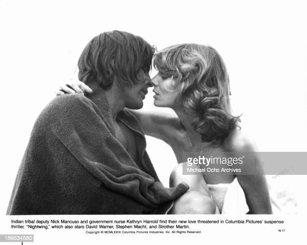 Nick Mancuso prepares to kiss Kathryn Harrold in a scene from the film 'Nightwing' 1979