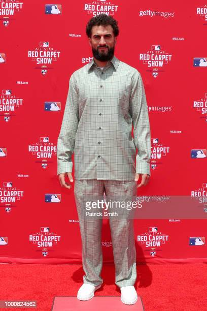 Nick Markakis of the Atlanta Braves and the National League attends the 89th MLB AllStar Game presented by MasterCard red carpet at Nationals Park on...