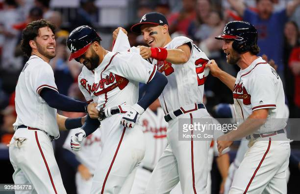 Nick Markakis of the Atlanta Braves celebrates with Dansby Swanson Ryan Flaherty and Charlie Culberson after hitting a threerun homer in the ninth...