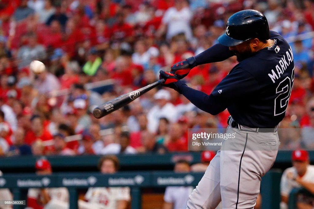 Nick Markakis #22 of the Atlanta Braves drives in a run with a sacrifice fly ball against the St. Louis Cardinals in the sixth inning at Busch Stadium on June 30, 2018 in St. Louis, Missouri.