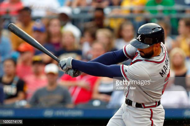 Nick Markakis of the Atlanta Braves hits an RBI single in the first inning against the Pittsburgh Pirates at PNC Park on August 20 2018 in Pittsburgh...