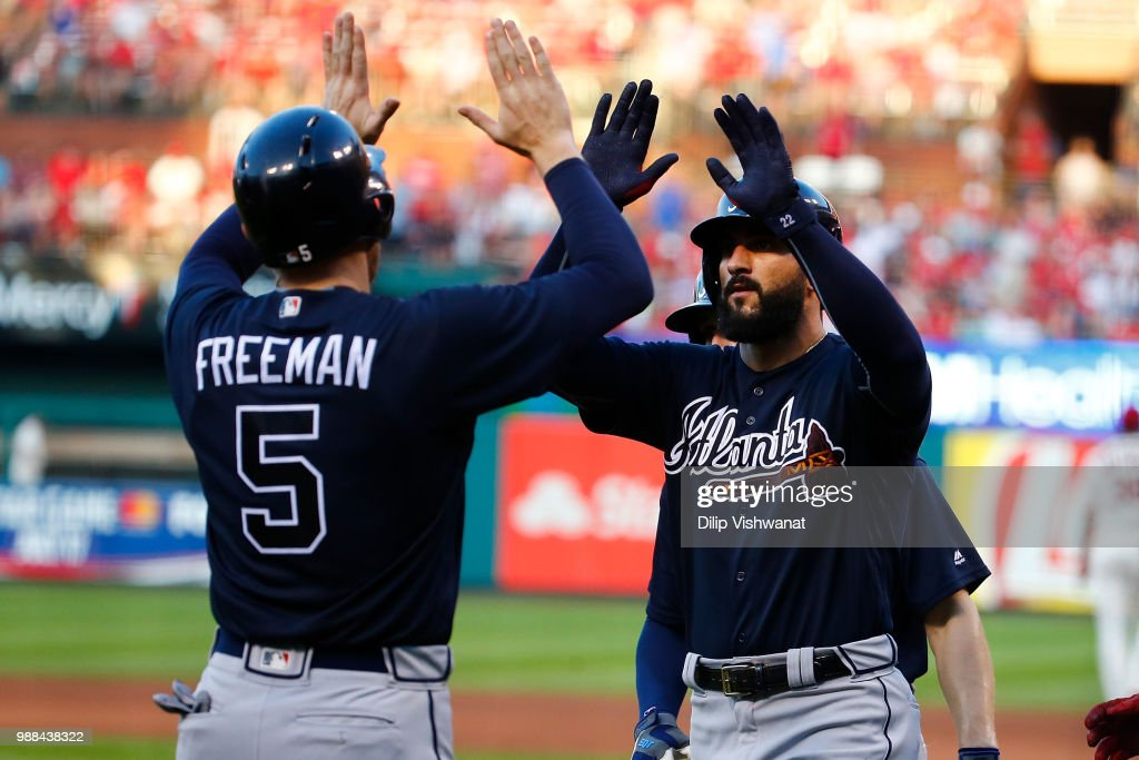 Nick Markakis #22 of the Atlanta Braves is congratulated after hitting a grand slam against the St. Louis Cardinals in the fifth inning at Busch Stadium on June 30, 2018 in St. Louis, Missouri.