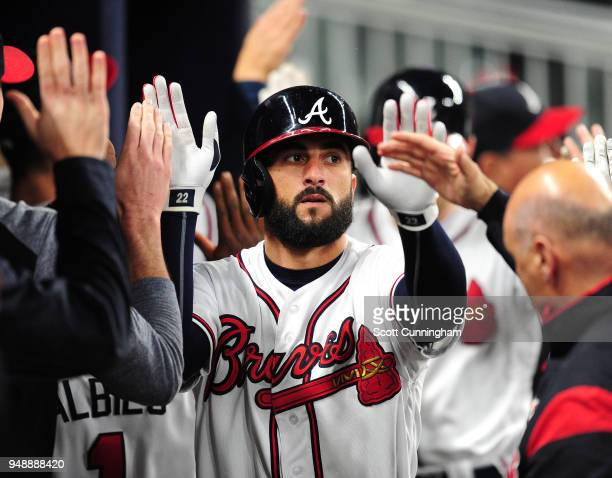 Nick Markakis of the Atlanta Braves is congratulated by teammates after scoring a seventhinning run against the New York Mets at SunTrust Park on...