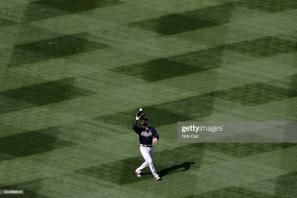 Nick Markakis #22 of the Atlanta Braves makes a catch against the Washington Nationals at Nationals Park on April 11, 2018 in Washington, DC.