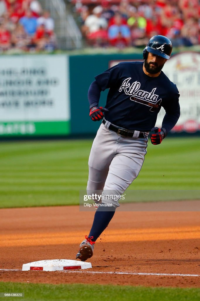 Nick Markakis #22 of the Atlanta Braves rounds third base after hitting a grand slam against the St. Louis Cardinals in the fifth inning at Busch Stadium on June 30, 2018 in St. Louis, Missouri.