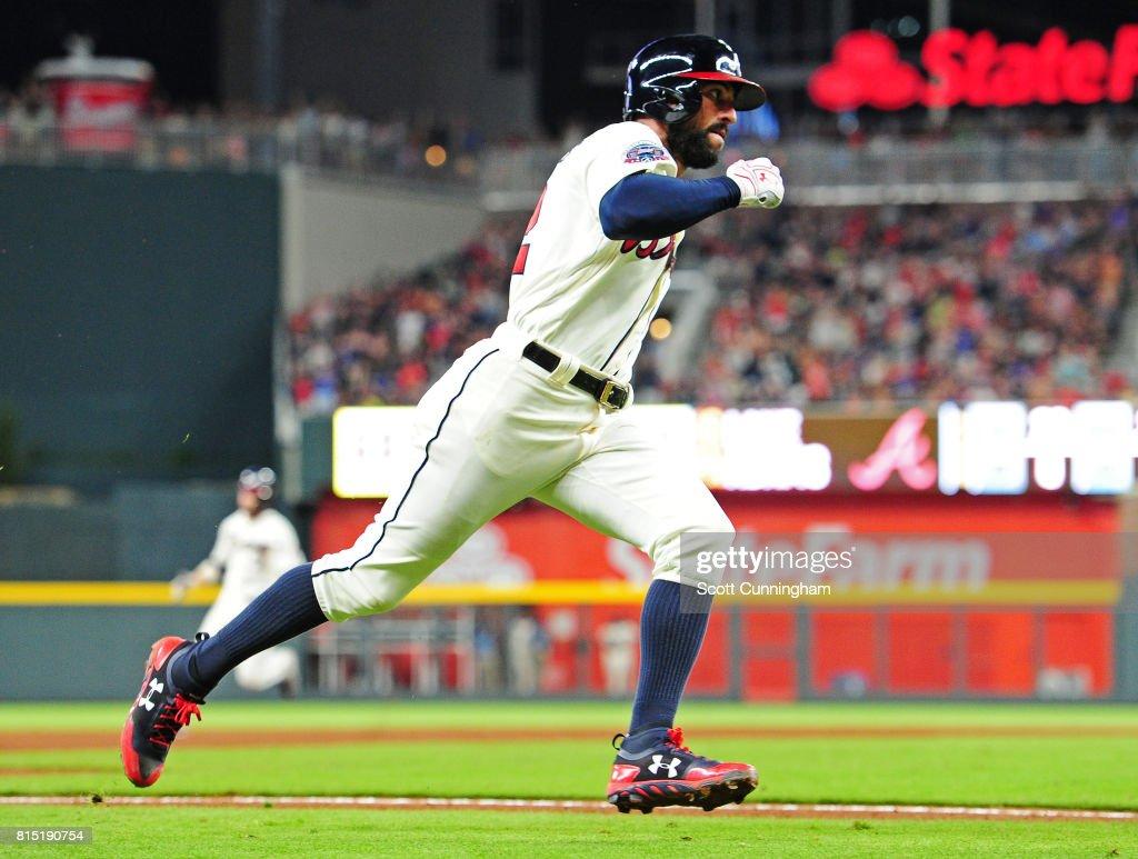 Nick Markakis #22 of the Atlanta Braves rounds third base to score a sixth inning run against the Arizona Diamondbacks at SunTrust Park on July 15, 2017 in Atlanta, Georgia.