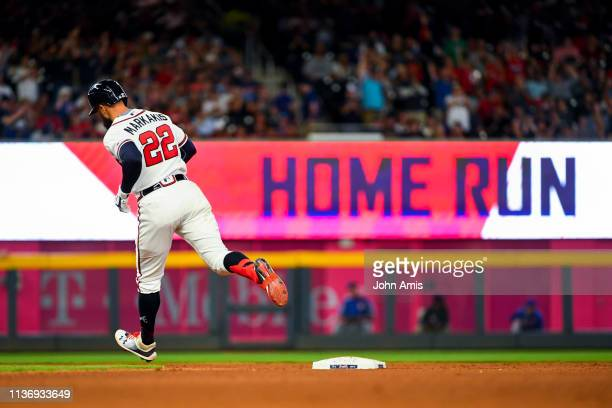 Nick Markakis of the Atlanta Braves runs bases during a home run against the New York Mets in the fourth inning at SunTrust Park on April 13 2019 in...