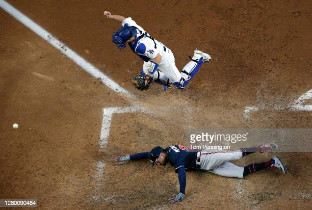 Nick Markakis of the Atlanta Braves scores a run against the Los Angeles Dodgers during the fifth inning in Game Two of the National League...