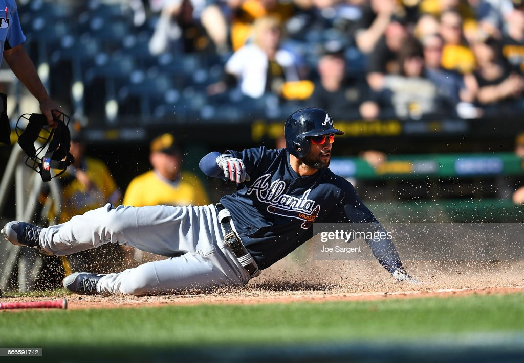 Nick Markakis #22 of the Atlanta Braves scores during the tenth inning against the Pittsburgh Pirates at PNC Park on April 9, 2017 in Pittsburgh, Pennsylvania.