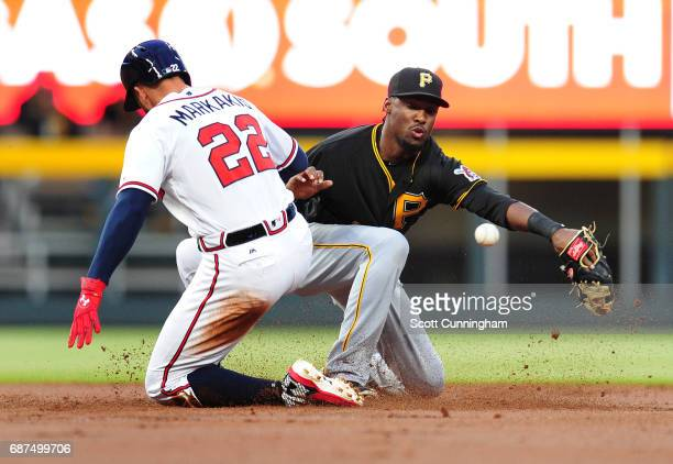 Nick Markakis of the Atlanta Braves slides into second base for a first inning double against Alen Hanson of the Pittsburgh Pirates at SunTrust Park...