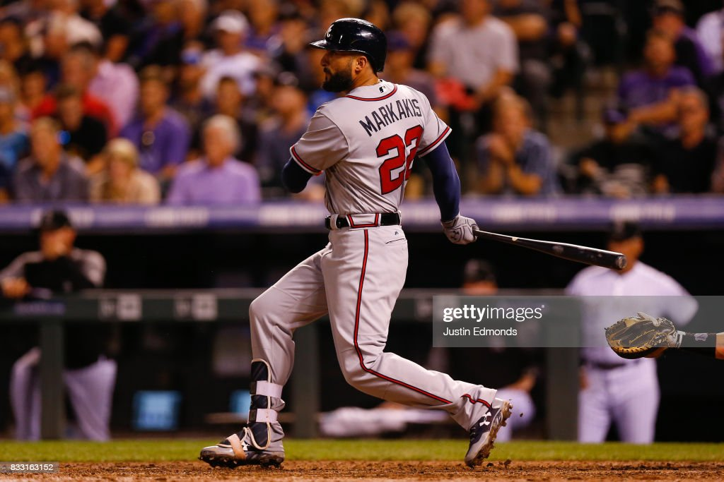 Nick Markakis #22 of the Atlanta Braves watches his two RBI single during the sixth inning during the game against the Colorado Rockies at Coors Field on August 16, 2017 in Denver, Colorado.