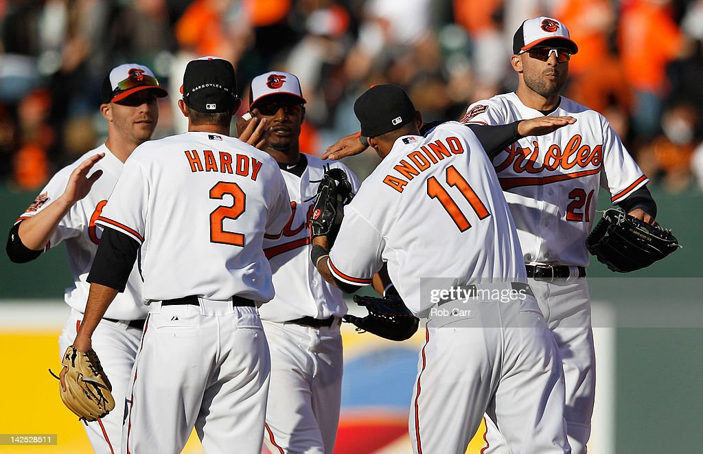 Nick Markakis #21 of the Baltimore Orioles celebrates the Orioles 4-2 win over the Minnesota Twins during opening day at Oriole Park at Camden Yards on April 6, 2012 in Baltimore, Maryland.