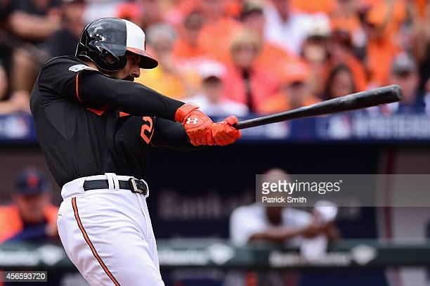 Nick Markakis of the Baltimore Orioles hits a two run home run to right field scoring teammate Jonathan Schoop in the third inning against Justin...