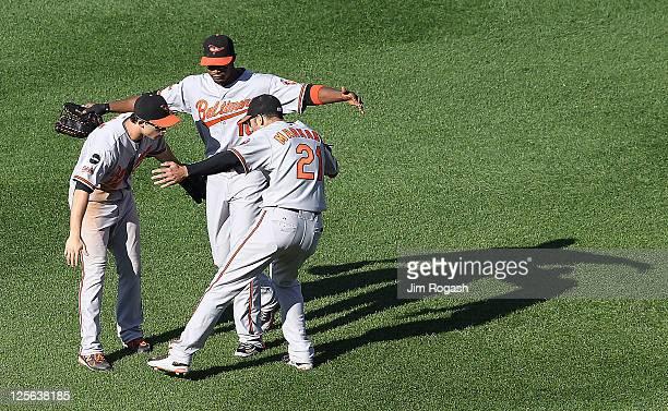 Nick Markakis of the Baltimore Orioles Matt Angle of the Baltimore Orioles and Nolan Reimold of the Baltimore Orioles celebrate a 65 win over the...