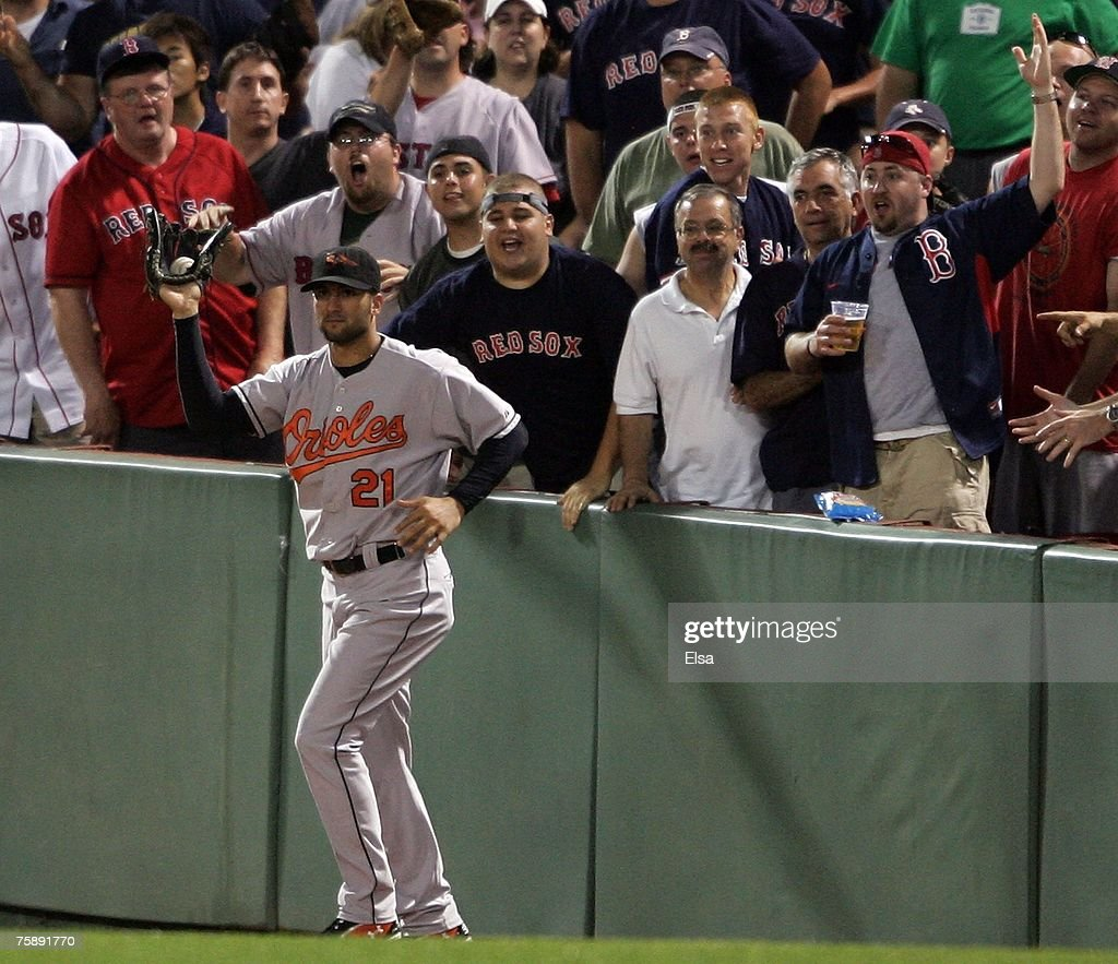 Nick Markakis #21 of the Baltimore Orioles shows the foul ball hit by Manny Ramirez of the Boston Red Sox after he caught it in the eighth inning on July 31, 2007 at Fenway Park in Boston, Massachusetts.