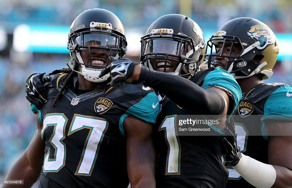 Nick Marshall #41 and Johnathan Cyprien #37 of the Jacksonville Jaguars celebrate an interception return during the game against the Indianapolis Colts at EverBank Field on December 13, 2015 in Jacksonville, Florida.