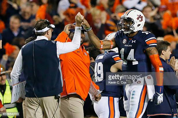 Nick Marshall celebrates with head coach Gus Malzahn of the Auburn Tigers in the fourth quarter against the Alabama Crimson Tide at JordanHare...
