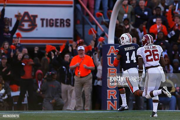 Nick Marshall of the Auburn Tigers scores a first quarter touchdown against the defense of Landon Collins of the Alabama Crimson Tide at Jordan-Hare...