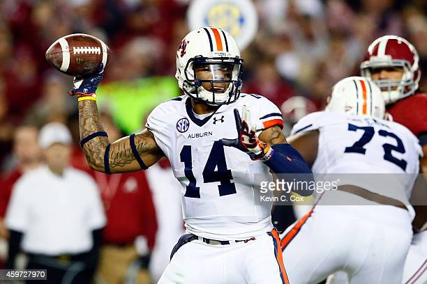 Nick Marshall of the Auburn Tigers throws a pass in the second quarter against the Alabama Crimson Tide during the Iron Bowl at Bryant-Denny Stadium...