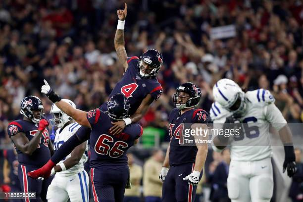 Nick Martin of the Houston Texans lifts Deshaun Watson in celebration after a fourth quarter touchdown pass against the Indianapolis Colts at NRG...
