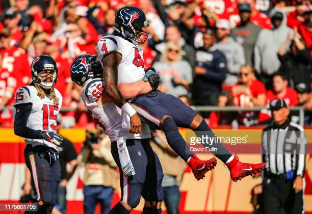 Nick Martin of the Houston Texans lifts his teammate Deshaun Watson of the Houston Texans after Watsons fourth quarter rushing touchdown in a 31-24...