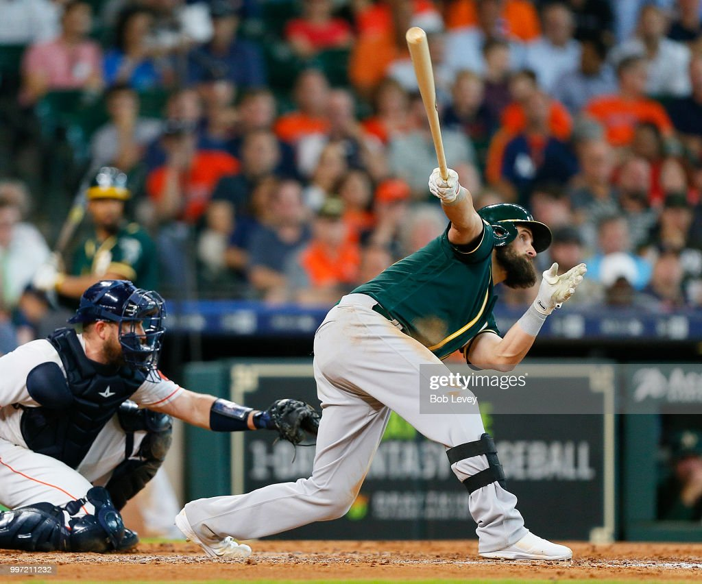 Nick Martini #38 of the Oakland Athletics doubles in the fifth inning scoring two runs against the Houston Astros at Minute Maid Park on July 12, 2018 in Houston, Texas.