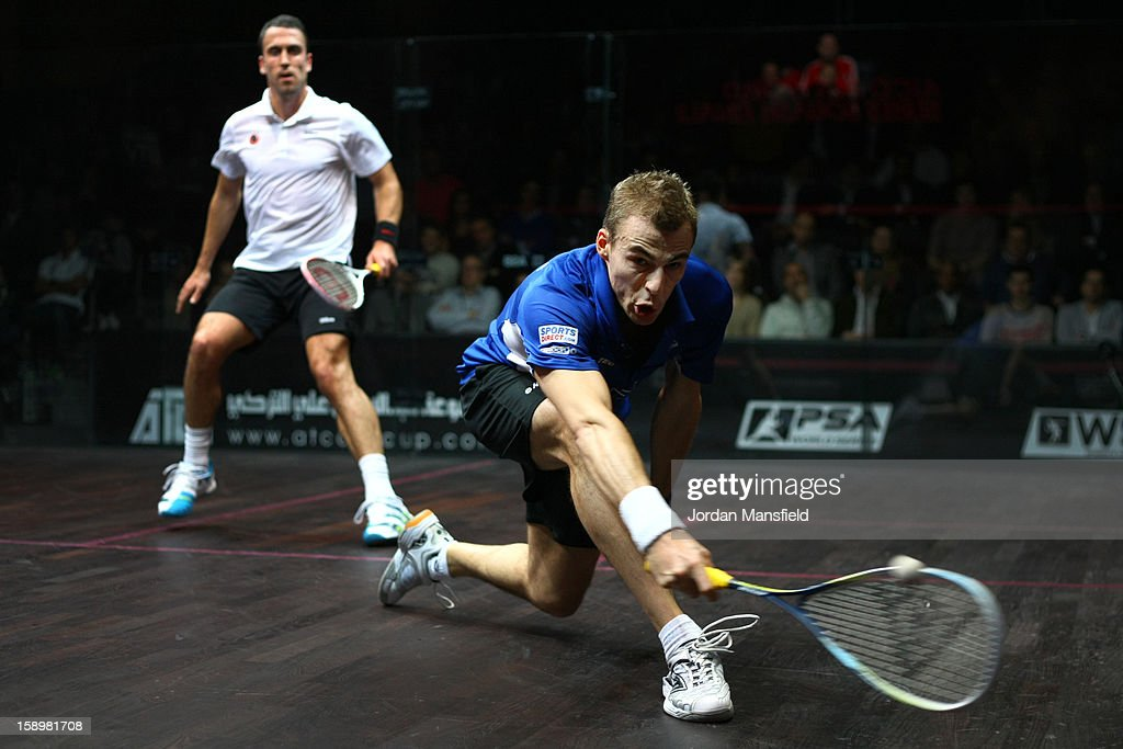 Nick Matthew of England in action against Peter Barker of England during Day 3 of the ATCO World Series Squash Finals played at Queens Club on January 4, 2013 in London, England.