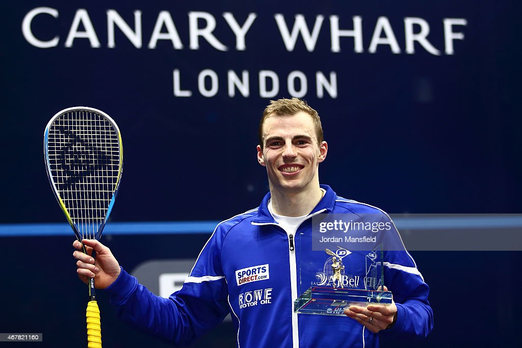 Nick Matthew of Great Britain poses for a photo with the trophy after winning the final against Simon Rosner of Germany during Day 5 of the Canary Wharf Squash Classic at the East Wintergarden on March 27, 2015 in London, England.