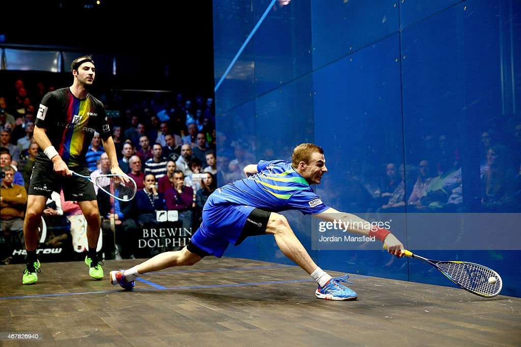 Nick Matthew of Great Britain (R) reaches for a shot during the final against Simon Rosner of Germany (L) on Day 5 of the Canary Wharf Squash Classic at the East Wintergarden on March 27, 2015 in London, England.