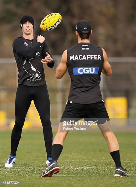 Nick Maxwell handballs during a Collingwood Magpies AFL training session at Olympic Park on July 9 2014 in Melbourne Australia