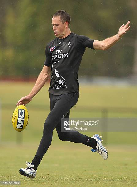 Nick Maxwell kicks the ball during a Collingwood Magpies AFL training session at Westpac Centre on March 27 2014 in Melbourne Australia