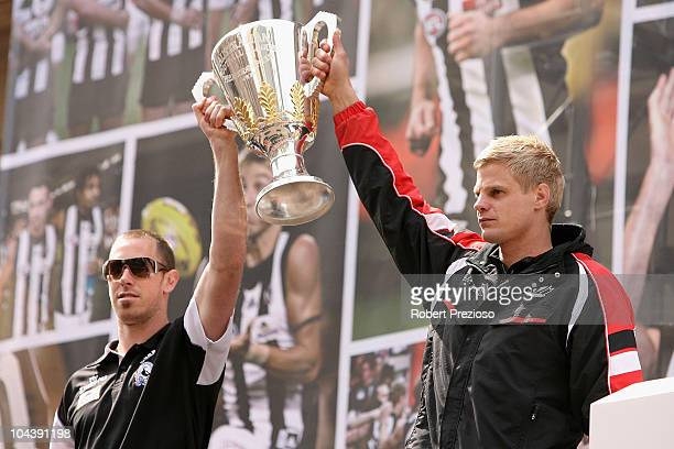 Nick Maxwell of Collingwood and Nick Riewoldt of St Kilda hold the grandfinal cup during the AFL Grand Final Parade on September 24 2010 in Melbourne...