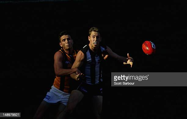 Nick Maxwell of the Magpies competes for the ball during the round 17 AFL match between the Collingwood Magpies and the Hawthorn Hawks at the...