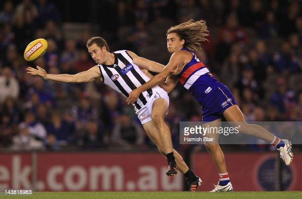 Nick Maxwell of the Magpies contests with Luke Dahlhaus of the Bulldogs during the round six AFL match between the Western Bulldogs and the...
