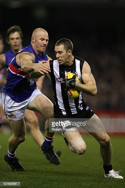 Nick Maxwell of the Magpies is tackled by Barry Hall of the Bulldogs during the round 11 AFL match between the Collingwood Magpies and the Western...