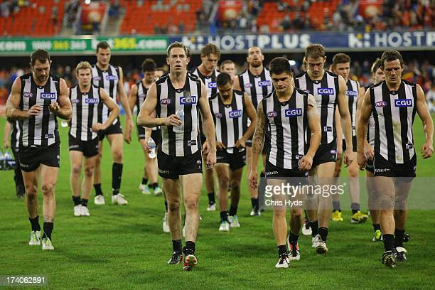 Nick Maxwell of the Magpies leads the team off after losing the round 17 AFL match between the Gold Coast Suns and the Collingwood Magpies at...