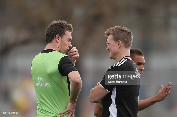 Nick Maxwell of the Magpies talks with Nathan Buckley coach of the Magpies during a Collingwood Magpies AFL training session at Gosch's Paddock on...
