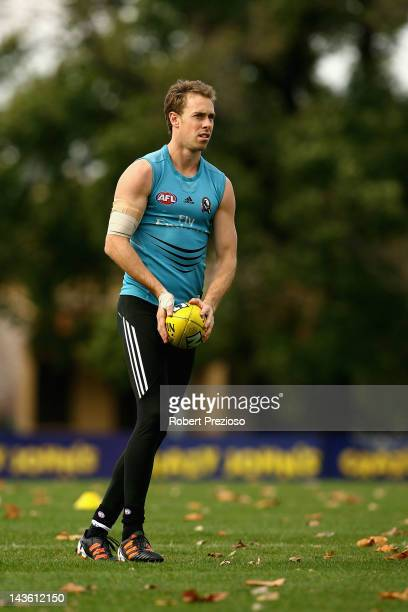 Nick Maxwell prepares to kick during a Collingwood Magpies AFL training session at Gosch's Paddock on May 1 2012 in Melbourne Australia