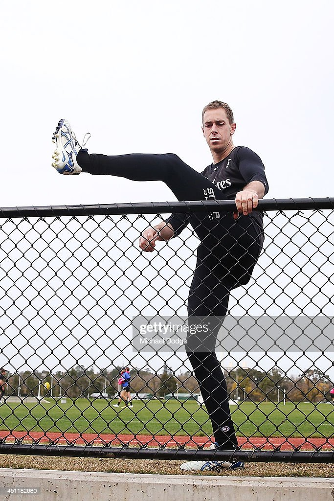 Nick Maxwell, recovering from a calf muscle injury, hops over the fence after a Collingwood Magpies training session at Westpac Centre on June 25, 2014 in Melbourne, Australia.