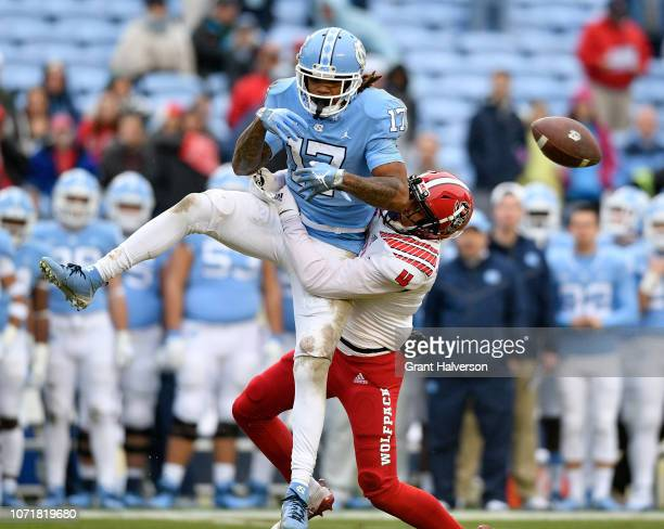 Nick McCloud of the North Carolina State Wolfpack breaks up a pass intended for Anthony RatliffWilliams of the North Carolina Tar Heels during the...
