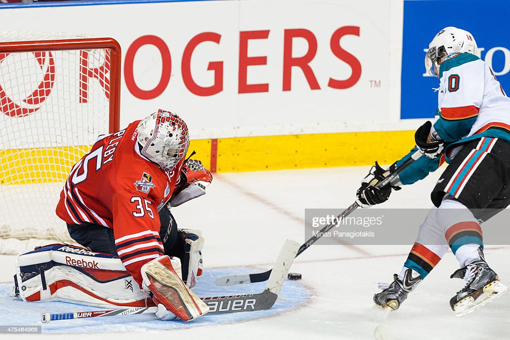 Nick Merkley #10 of the Kelowna Rockets is stopped by goaltender Ken Appleby #35 of the Oshawa Generals during the 2015 Memorial Cup Championship at the Pepsi Coliseum on May 31, 2015 in Quebec City, Quebec, Canada.