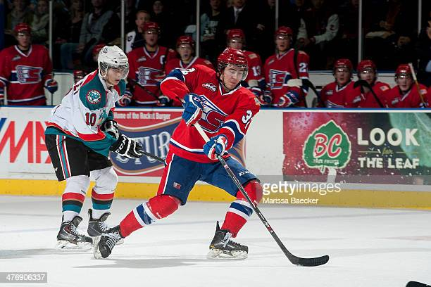 Nick Merkley of the Kelowna Rockets stick checks Colton Bobyk of the Spokane Chiefs during the second period on March 5, 2014 at Prospera Place in...