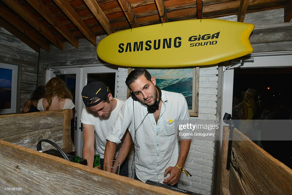 Nick Millhiser (L) and Alex Frankel of Holy Ghost! at The Surf Lodges Summer DJ Series to launch the new Samsung Giga speaker system in Montauk, NY on July 7th, 2013.